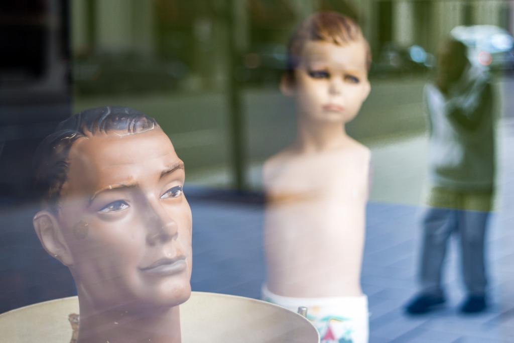 Mannequins see a man.
