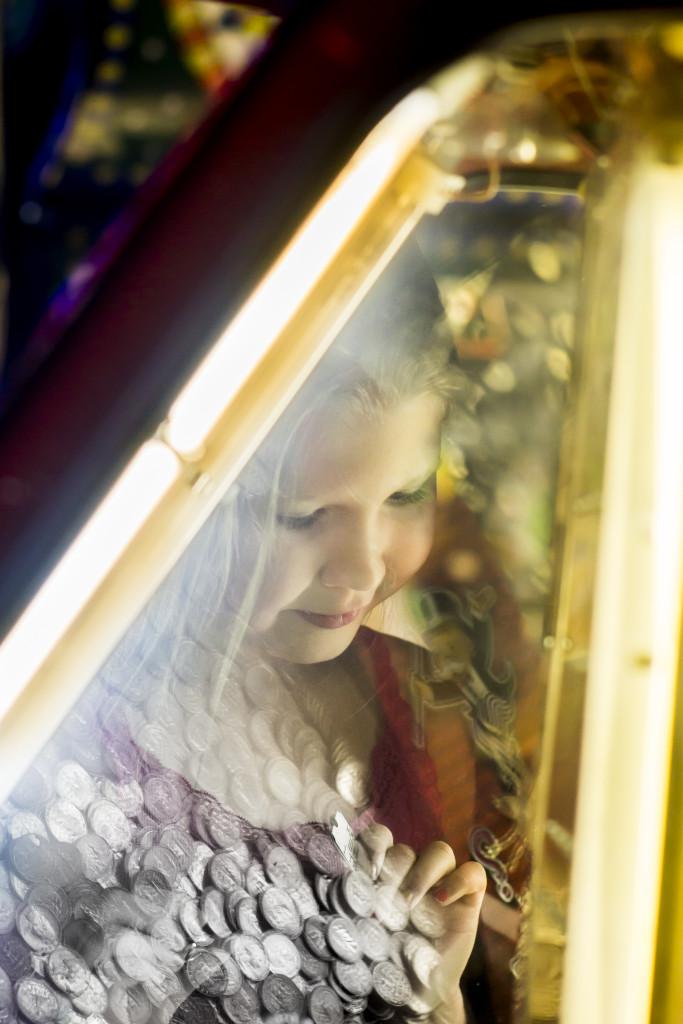 A young girl at an arcade